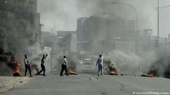 Several shops are damaged and cars burnt in Jeppestown, Johannesburg, following a night of violence.
