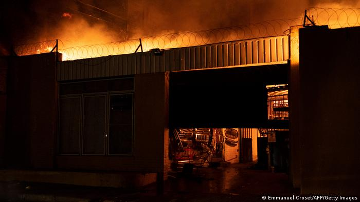 An auto spare parts shop, owned by a migrant, burns during protests in Hillbrow, Johannesburg