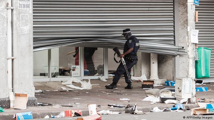 Several shops are damaged and cars burnt in Durban, following a night of violence.