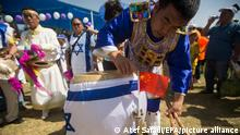 01.10.2015 | epa04958843 A Christian from China participates in the 62th annual Jerusalem March, marking the Jewish holiday of Sukkot in support of Israel, in Jerusalem, Isreal, 01 October 2015. The event was organized by the International Christian Embassy in Jerusalem. Thousands of Christians from around the world visit the capital as part of the yearly Feast of Tabernacles events. EPA/ATEF SAFADI ++