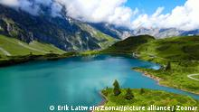 Flight over a wonderful mountain lake in the Swiss Alps - Lake Truebsee on Mount Titlis - travel photography