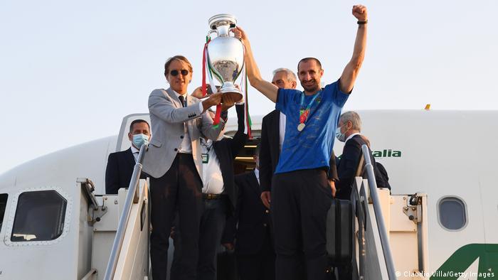 Coach Roberto Mancini and captain Giorgio Chiellini lift The Henri Delaunay Trophy