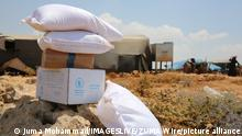 04.07.2021 July 4, 2021: Aleppo, Syria, 04 July 2021. Aid is delivered to displaced civilians in a camp in Darat Izza, northwest of Aleppo. Currently humanitarian aid reaches the rebel-held area in northwest Syria through the Bab Al-Hawa border crossing, which the UN Security Council approved in 2014, three years after the start of the Syrian conflict. The UN is due to hold a vote on July 10 to discuss the renewal of the authorisation for aid to transit through the crossing. Local and international humanitarian organisations have highlighted that the crossing is the only lifeline for northwest Syria and warned of a major humanitarian catastrophe for the people living in the region, especially for those displaced, if the border was shut (Credit Image: © Juma Mohammad/IMAGESLIVE via ZUMA Wire