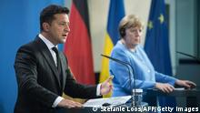 German Chancellor Angela Merkel (R) and Ukrainian President Volodymyr Zelensky give statements ahead of talks at the Chancellery in Berlin on July 12, 2021. (Photo by STEFANIE LOOS / POOL / AFP) (Photo by STEFANIE LOOS/POOL/AFP via Getty Images)