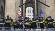 TBILISI, GEORGIA - JULY 12, 2021: Police officers observe a rally outside the offices of the Georgian Parliament following the death of TV Pirveli journalist Lekso Lashkarava injured in the July 5 anti-LGBT violence. Protesters demand the resignation of Georgian Prime Minister Irakly Garibashvili and Grigol Liluashvili, head of the State Security Service of Georgia. Cameraman Lashkarava was one of 50 journalists who were attacked by groups opposing Tbilisi Pride. Lashkarava was found dead at his home after being released from hospital. David Mdzinarishvili/TASS