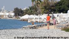 June 10, 2021, Larnaca, Cyprus: A woman seen walking at the Oroklinis beach. Larnaca Cyprus - ZUMAs197 20210610_zab_s197_010 Copyright: xGeorgexChristophoroux