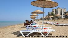 Tourists relax on a beach fenced by the Turkish military since 1974 in the abandoned coastal area of Varosha, a suburb of the city of Famagusta in Turkish-controlled northern Cyprus. Saturday, June 26, 2021. (Photo by Danil Shamkin/NurPhoto)