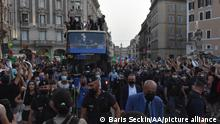 ROME, ITALY, JULY 12: Italy's players celebrate on an open double decker in downtown Rome, Italy on July 12, 2021, after their victory of the UEFA EURO 2020 football tournament in the final played on July 11 at Wembley stadium in London against England. Baris Seckin / Anadolu Agency