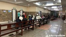 Patients wait outside of the outpatient ward at the Institute of Mental Health and Neurosciences in Srinagar. Kashmir is seeing a surge in reports of mental health problems and drug addiction.