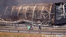 Brookside mall burns after being looted, as protests continue following imprisonment of former South Africa President Jacob Zuma, in Pietermaritzburg, South Africa, July 12, 2021. REUTERS/Rogan Ward