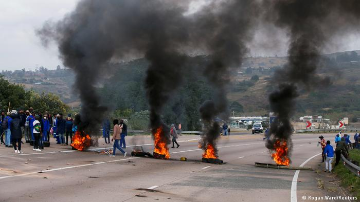 Supporters of former South African President Jacob Zuma block the freeway with burning tyres