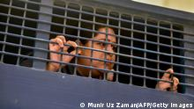 Investigative journalist Rozina Islam is seen inside a prison van in Dhaka on May 18, 2021, a day after being arrested on accusation of stealing documents and taking images by the health ministry. (Photo by Munir UZ ZAMAN / AFP) (Photo by MUNIR UZ ZAMAN/AFP via Getty Images)