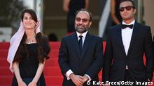 CANNES, FRANCE - JULY 13: Director Asghar Farhadi (C) and Amir Jadidi (R) attend the Ghahreman (A Hero) screening during the 74th annual Cannes Film Festival on July 13, 2021 in Cannes, France. (Photo by Kate Green/Getty Images)