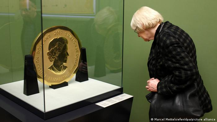 A visitor at the Bode Museum looks at the 'Big Maple Leaf' on display