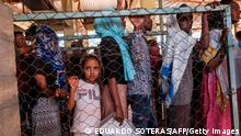 Eritrean refugees pictured in a distribution queue at Mai Aini camp earlier this year