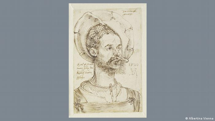 Dürer's print shows a man with an elaborate hat and hair ornaments