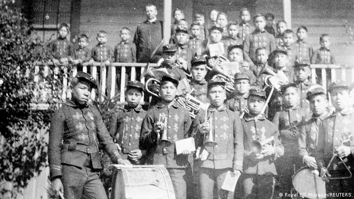 Children pose outside the Kuper Island Residential School in British Columbia