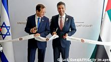 14.07.2021 Israeli President Isaac Herzog (L) and Emirati Ambassador to Israel Mohamed al-Khaja cut the ribbon at the new UAE embassy in Tel Aviv on July 14, 2021. - The United Arab Emirates opened its embassy in Israel, housed in Tel Aviv's new stock exchange building, in the latest step solidifying ties after a US-brokered normalisation deal last year. The venue in the heart of Israel's financial district highlighted the central role economic cooperation has played since UAE became only the third majority Arab nation to recognise the Jewish state. (Photo by JACK GUEZ / AFP) (Photo by JACK GUEZ/AFP via Getty Images)