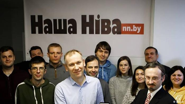 Nasha Niva reporters and editors in a group photo.