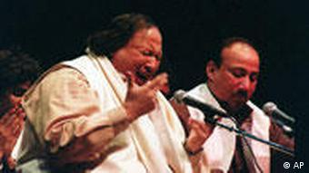 Pakistani singer Nusrat Fateh Ali Khan, left, with his band