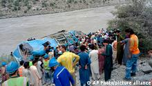 Local residents and rescue workers gather at the site of bus accident, in Kohistan Kohistan district of Pakistan's Khyber Pakhtunkhwa province, Wednesday, July 14, 2021. A bus carrying Chinese and Pakistani construction workers on a slippery mountainous road in northwest Pakistan fell into a ravine Wednesday, killing a dozen of people, including Chinese nationals, and dozens were injured, a government official said. (AP Photo)