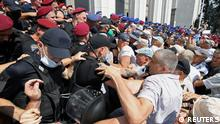 Retired Ukrainian police officers attempt to storm the parliament building during a rally to demand an increase in their pensions, in Kyiv Ukraine July 14, 2021. REUTERS/Stringer