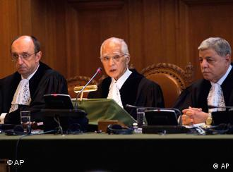 President of the court Judge Owada, flanked by Vice-President Judge Peter Tomka and Judge Awn Shawkat Al-Khasawneh at the World Court in The Hague