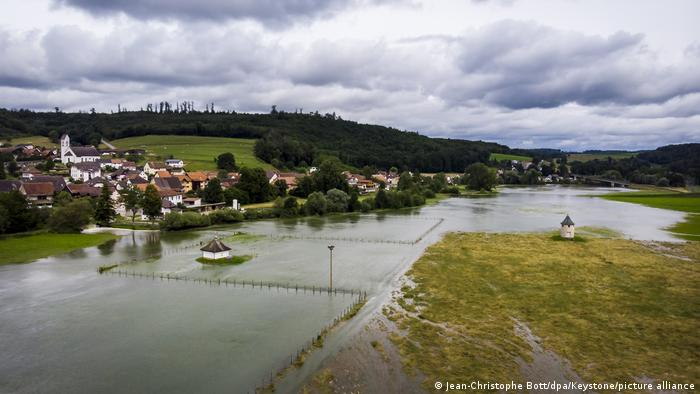 Allaine River in Switzerland bursting its banks after heavy rains