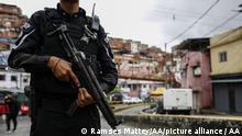 CARACAS, VENEZUELA - JULY 9: Members of a special unit of the National Police set up an alcabala in one of the main streets of the Cota 905 neighborhood after three days of confrontations with alleged members of a criminal gang in Caracas on July 9, 2021. Venezuelan security forces entered the Four poor neighborhoods in the capital Caracas seek on Friday to end two days of clashes with armed gangs that have claimed several lives. Ramses Mattey / Anadolu Agency