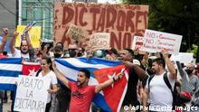 Cuban residents in Costa Rica demonstrate in front of the US embassy in San Jose, on July 13, 2021 asking for a military and humanitarian intervention in Cuba. (Photo by Ezequiel BECERRA / AFP) (Photo by EZEQUIEL BECERRA/AFP via Getty Images)