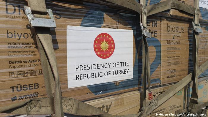 Boxes of medical supplies and vaccines bearing the logo of Turkey's president