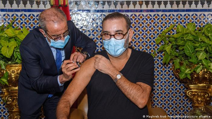 King Mohammed VI receives the first shot of a COVID-19 vaccine in Fez, Morocco