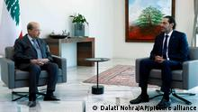 In this photo released by Lebanon's official government photographer Dalati Nohra, Lebanese President Michel Aoun, left, meets with Lebanese Prime Minister-Designate Saad Hariri, at the presidential palace, in Baabda, east of Beirut, Lebanon, Wednesday, July 14, 2021. (Dalati Nohra/Lebanese Official Government via AP