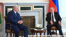 Russian President Vladimir Putin, right, listens to Belarusian President Alexander Lukashenko during their meeting in St. Petersburg, Russia, Tuesday, July 13, 2021.(Alexei Nikolsky, Sputnik, Kremlin Pool Photo via AP)