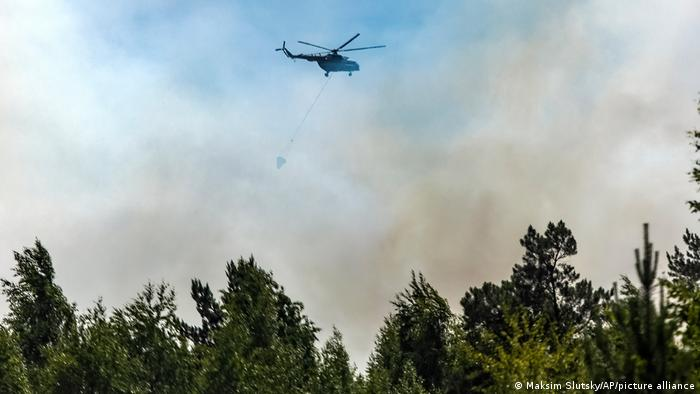 Helicopter involved in fighting the fires
