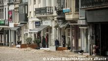 People put up barriers and lay sandbags to protect their shops from flood waters in the center of Spa, Belgium, Wednesday, July 14, 2021. A code red was issued in parts of Belgium on Wednesday as severe rains hit the area. (AP Photo/Valentin Bianchi)