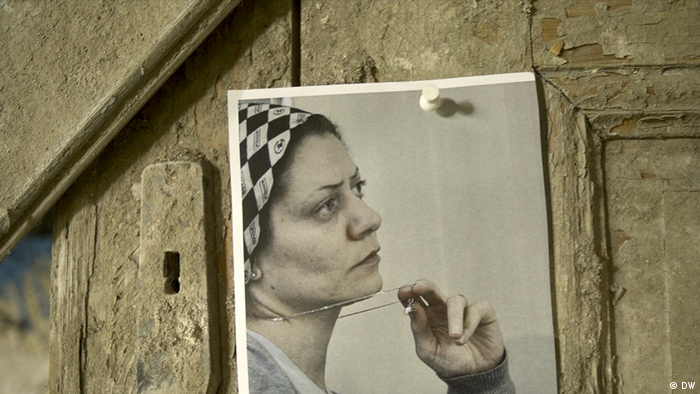 An image of Syrian human rights lawyer Razan Zaitouneh, who was disappeared in December 2013, hangs on a door
