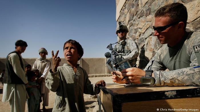 US soldiers interact with people in Afghanistan