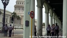 Police stand guard near the National Capitol building in Havana, Cuba, Wednesday, July 14, 2021, days after protests. Demonstrators voiced grievances on Sunday against goods shortages, rising prices and power cuts, and some called for a change of government. (AP Photo/Eliana Aponte)