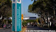 A sign stands at an entrance to the Armed Forces Hospital where Brazilian President Jair Bolsonaro was admitted in Brasilia, Brazil, Wednesday, July 14, 2021. Bolsonaro was admitted Wednesday to determine what is causing a hiccup that has lasted for days, according to a statement from the President's office. (AP Photo/Eraldo Peres)