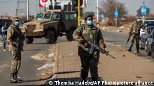 Soldiers patrol outside a shopping mall in Vosloorus, east of in Johannesburg, South Africa, Wednesday, July 14, 2021. South Africa's rioting continued Wednesday as police and the military struggle to quell the violence in Gauteng and KwaZulu-Natal provinces. The violence started in various parts of KwaZulu-Natal last week when Zuma began serving a 15-month sentence for contempt of court. (AP Photo/Themba Hadebe)