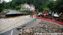 A destroyed road next to the Ahr river is seen on a flood-affected area following heavy rainfalls in Schuld, Germany, on July 15, 2021. REUTERS/Wolfgang Rattay