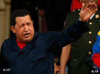 Venezuela's President Hugo Chavez waves to the press at Miraflores presidential palace in Caracas, Venezuela, Thursday July 22, 2010. Chavez severed Venezuela's diplomatic relations with Colombia on Thursday over claims he harbors guerrillas. (AP Photo/Fernando Llano
