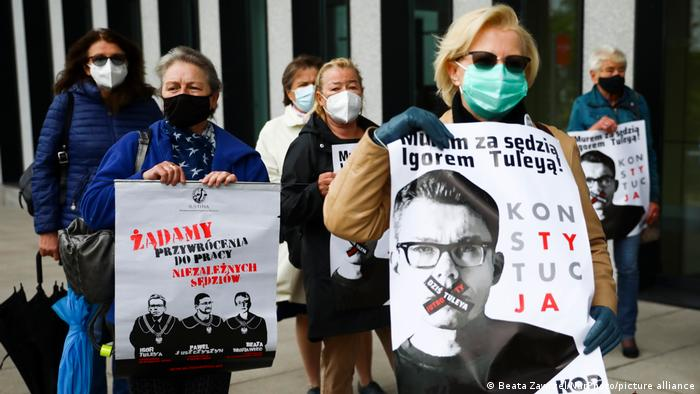 Judges, prosecutors, lawyers and supporters demonstrate in a rally in front of a court in support of judical independence in Krakow, Poland on May 18, 2021