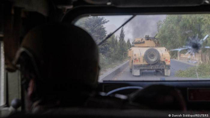 A member of the Afghan Special Forces in a vehicle convoy fires on Taliban positions in Kandahar this month