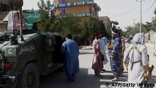 Afghan security personnel stand guard along a road amid ongoing fight between Afghan security forces and Taliban fighters in the western city of Qala-i- Naw, the capital of Badghis province, on July 7, 2021 - The Taliban launched a major assault on a provincial capital in Afghanistan on July 7, the first since the US military began its final drawdown of troops from the country, as insurgents press on with a blistering offensive. (Photo by - / AFP) (Photo by -/AFP via Getty Images)