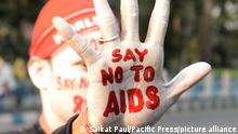 30.11.2018 Kolkata An activist paints his face and hand with HIV/AIDS awareness message during a campaign on the eve of Worlds AIDS Day. World AIDS Day is observed on December 01 every year to raise awareness about HIV/AIDS dedicated to raising awareness of the AIDS caused by the spread of HIV infection and mourning those who have died of the disease. (Photo by Saikat Paul/Pacific Press)