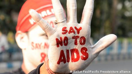 Hand held up with writing on it reading: 'say no to aids'