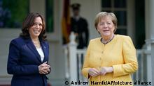 Vice President Kamala Harris greets German Chancellor Angela Merkel as she arrives at the Vice President's residence, the Naval Observatory, Thursday, July 15th, 2021, in Washington. (AP Photo/Andrew Harnik)