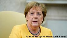 German Chancellor Angela Merkel looks on as she meets with President Joe Biden in the Oval Office of the White House, Thursday, July 15, 2021, in Washington. (AP Photo/Evan Vucci)